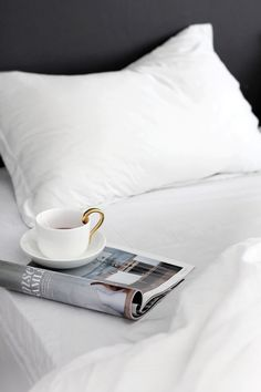 Comfort - morning coffee in bed with the favorite magazine