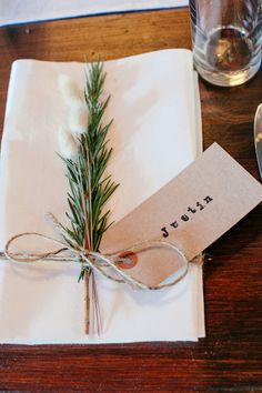 Cost effective way of creating placecards - use kraft tags and twine, and hand stamp guest's name
