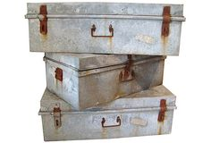 "As described by David Bell Antiques:  A set of three large vintage industrial zinc trunks, American, 1940s. Dimensions: smaller, 30""W x 17""D x 12""H; larger, 36""W x 19""D x 11.5""H."