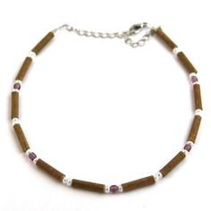 Hazelwood Amethyst Anklet! Effective in reducing acid-based ailments and symptoms, such as eczema, acid-reflux, and heartburn, and ulcers. Must be placed directly on the skin and worn 24/7. Made with nylon-coated steel wire, hazelwood and assorted beads, and nickel clasp (lobster style opening).