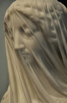 The illusion of transparent cloth from pure marble (by Giovanni Strazza)