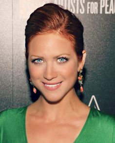 Brittany Snow (with red hair) as Kira's best friend, Faye Davenport.