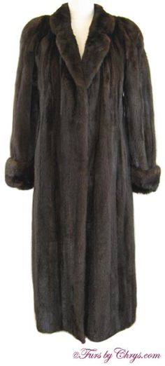 SOLD! Mahogany Mink Coat #MM781; Excellent Condition; Size range: 10 - 14 Average or Tall. This is a stunning genuine natural dark mahogany mink fur coat; the color is a very deep, rich, dark mahogany, and is gorgeous. It appears to have been rarely, if ever, worn. It features a small notched collar, built-in shoulder pads and deep, adjustable turn-back cuffs. The lining is solid bronze. When you wear it, you will feel enchanting and elegant!