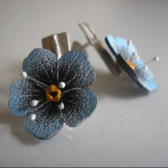 Simple earrings on a stick made from silver 930 and natural leather. Perfectly with the bracelet Forest with forget-me.