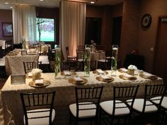 Chiavari chairs and ivory rosette tablecloths... By Special Occasions East. Michigan