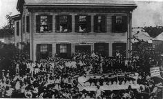 In 1858, Lincoln squared off against Stephen Douglas for Illinois' Senate seat.  The battle sparked seven heated debates on slavery.  Here, supporters gather outside Lincoln's Springfield home.  Lincoln is the tall, white figure by the doorway.