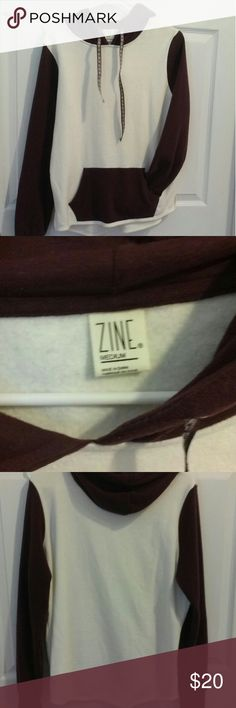 Women's zumiez hoodie Maroon and cream/white sweat shirt, Brand- Zine, wore once so close to brand new, no stains in great shape,  super comfortable. The size runs a lettle weird so if your a size small this would fit good. Im a size medium so this fit a little tighter than I like. Make me an offer  same day shipping Zine Clothing Jackets & Coats