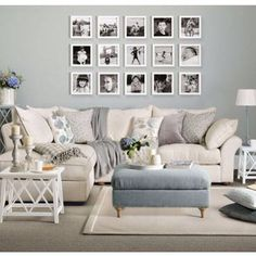 Lounge room- love the photo arrangement. Sofa sofas and pale colour scheme gives a modern country look. If you like this, come on over and join us at www.FlorenceAndFreya.com. Join up for a whole home decorating resource library.