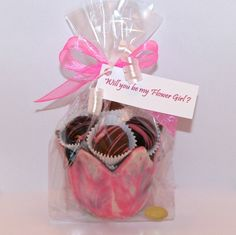An elegant way to ask your Flower Girl to share your celebration.  An edible chocolate tulip shaped cup filled with truffles and  a tag to ask