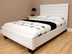 faux leather with high buttoned headboard - in a nicer setting with nicer bedding, this might work£279