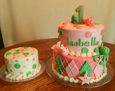 Isabella's first birthday cake and smash cake! Pink ocean theme, 10in and 8in 2 layer round, 2 tier cake and 6in smash cake! All buttercream and candy clay accents! All edible, no fondant!! We got to make Isabella's baby shower cake and now we got to make her first birthday cake! Makes it even more special!!!  https://www.facebook.com/angelas.cakes2011