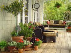 Deck/porch ideas - group terra cotta pots together