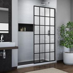DreamLine French Linea Toulon H x to W Frameless Fixed Satin Black Shower Door at Lowe's. The DreamLine Toulon, part of the French Linea collection, is a single panel, walk-in shower design with a modern industrial touch to complement your Very Small Bathroom, Master Bathroom, Frameless Sliding Shower Doors, Sliding Doors, Fiberglass Shower, Black Shower, Shower Screen, Shower Panels, Shower Enclosure