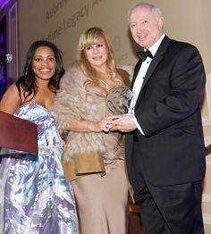 Mykesha Robinson and Daphna Ziman present the CUN Lifetime Legacy Award to Aubrey Chernick