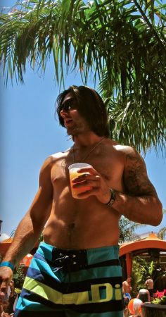 Kristopher Letang....on the beach, with a cold beverage (most likely of the adult variety), and WITHOUT a shirt? Oh, YEAH!!!