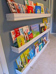 So popular right now, wall shelves for books are a great way to foster a love of literature right from the start!  #ARTiculatePRINTS #booksforbaby