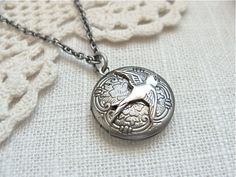 Antique silver locket necklace.  Floral etched locket with a small sparrow.  Photo keepsake jewelry.. $18.00, via Etsy.