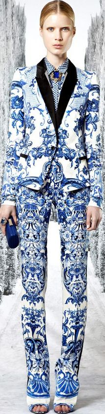 Roberto Cavalli 2013. Model is way too skinny, would love to see this on a real sized woman. Very cool suit.