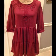 Brand New! Adorable Free People Dress! This dress is too cute!  Tunic style Scarlet dress with Three quarter length sleeves. Cutout detailing around the neck. Stylish open crossed back. Ruffled hem. So much detail and style. Still has original tags attached. Free People Dresses