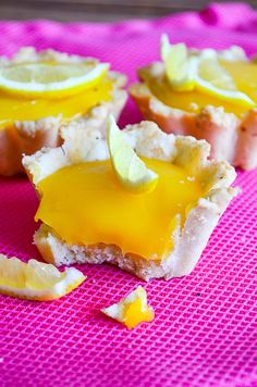 These Lemon Curd Tartlets are so refreshing with the curd and lemon wedges toping. They are served chilled, so these make a perfect baked treat for summer! | giverecipe.com | #tartlets #lemoncurd #baking #summerdesserts #citrus #refreshingrecipes