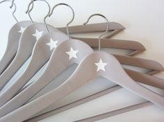 We have so many old wooden hangers... could do this with them :-)