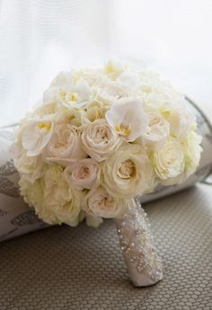Creamy white roses and pearls make for a timeless bridal bouquet at @Mandy Bryant Dewey Seasons Hotel San Francisco.
