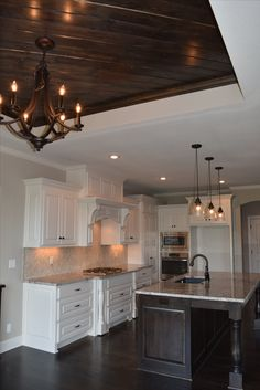 Wood Accent, Large Island, Ceiling Accent, Lighting, White Cabinets, Two Toned Cabinets, Dark Wood, Kitchen Design, New Home Design
