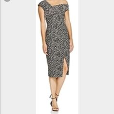 N Nicholas Off The Shoulder Dress One Word. Amazing!!!! I love this dress. My personal favorite in my closet. This dress fits amazingly, tight fit, thick fabric. Makes the body look slim. Love it. I recommend going a size up in this dress, fit is small. N Nicholas Dresses One Shoulder