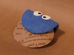 Could easily do the whole invitation in paper instead of cloth like this person used for cookie monster