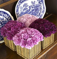Carnations but I've seen this done with roses too; nice in Peter's Pottery square 'berry' bowls down the center of a table