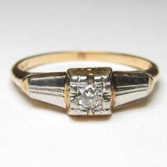 A classic engagement ring from the Art Deco era c.1930s! This ring is SO very Deco, with sleek geometric lines and luxe two tone Yellow and