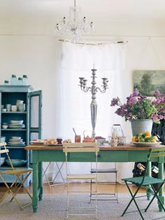 color, curtains, chandelier, wood floor, rug under table, table, chairs(not for dining room, kitchen?) candle stick, art to right