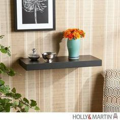 Holly & Martin Cadence 24 Inch Floating Shelf - Black by Holly & Martin. $23.99. This floating wall shelf is perfect for any room of your home. Easy as hanging a picture this shelf shows no visible supports and actually appears to be floating. Just perfect for displaying pictures and family artifacts, this piece is sure to make a splash in your home.