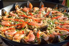 #Paella: this rice dish is world-famous and delicious, so you can't leave #Spain without trying some. While paella originally comes from Valencia, you can also find it in other cities (just beware of tourist traps!) http://devourbarcelonafoodtours.com/where-to-eat-paella-in-barcelona/
