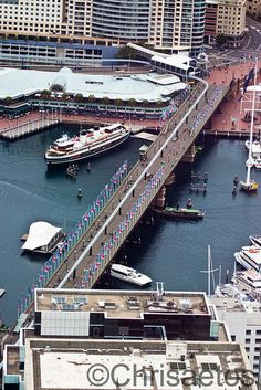 Darling Harbour, Sydney, New South Wales, Australia.  ** Begore the Monorail was taken down. The old ferry moored beside the Pyrmont Bridge is the South Steyne, a decommissioned Harbour ferry which is now a restaurant and function centre.