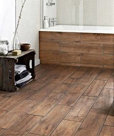 Compromise flooring - wood effect tiles. Has matching skirting!