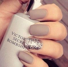 Love this matte taupe manicure with a silver glitter accent nail. Photo via Beauty There