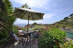 Nepenthe, a cosy and charming Grade II listed cottage, features magnificent views of Polperro harbour. Old Faithful, Al Fresco Dining, Sandy Beaches, Holiday Destinations, Favorite Holiday, Cornwall, Cosy, Old Things, Cottage