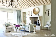 A seating area by the fireplace is a dreamy spot for lounging.