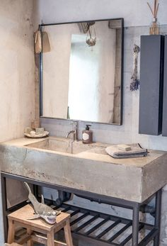 Concrete sink, cool soap dispenser, neat mirror, dried lavender, and THAT SHARK. This salle de bain has funky French written all over it. Industrial Bathroom Vanity, Bathroom Interior, Design Bathroom, Master Bathroom, Industrial Mirrors, Bathroom Pink, Industrial Door, Industrial Shelving, Industrial Wallpaper