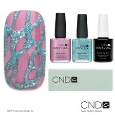 "This Aurora collection nail design, entitled ""Cracked Glacier,"" can be created using VINYLUX™ Weekly Polish in the shades Tundra and Glacial Mist. Don't forget the Glossing Block!"