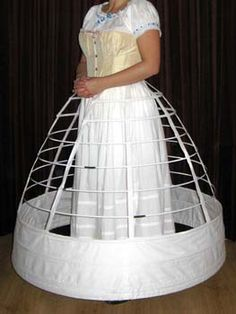 To keep a consistency to the era, Lady Bracknell would wear a crinoline to support her skirt to form a perfect bell shape. The crinoline would be white because it would not be shown to anybody but Lady Bracknell.