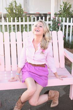Perfection. Cowboy boots, gorg color outfit, and a pink bench. Does this scream Kirsten? LOVE THE COLOURRRR