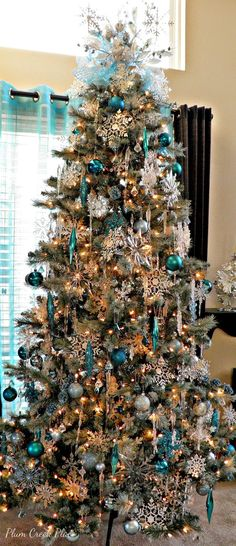 Plum Creek Place, Blue Christmas Tree Ideas via Refresh Restyle Teal Christmas Tree, Beautiful Christmas Trees, Christmas Tree Themes, Holiday Decor, Frozen Christmas Tree, Christmas Villages, Victorian Christmas, Christmas Christmas, White Christmas