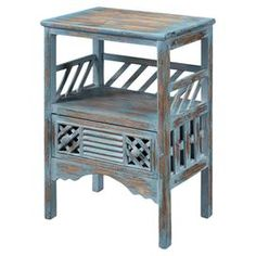 Distressed one-drawer accent table with lattice-style panels and an open display compartment.  Product: Accent tableConstruction Material: WoodColor: Bali blueFeatures:  One shelfOne drawerLouvered details Dimensions: 28.75 H x 19.25 W x 14 D