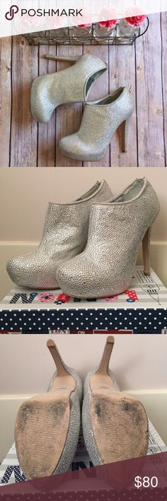 Steve Madden Silver Rhinestone Sparrkk Booties Steve Madden Silver Rhinestone Sparrkk Booties. Sz 6.5, on-trend ankle booties covered with rhinestones. A 5 inch heel, 1 1/4 inch hidden platform, and zipper in the back complete this dazzling style. Shoe Details: leather upper, man made sole. Steve Madden Shoes