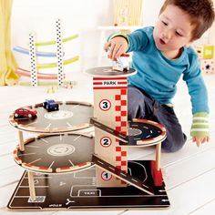 With four levels of parking, gas pumps, and a roof top landing pad, busy drivers will be coming and going in every direction. Set comes with 2 cars, a helicopter and knob-operated car elevator. Enter code THANKS15 for 15% OFF. Offer ends 11/30/14 at 11:59pm PT.