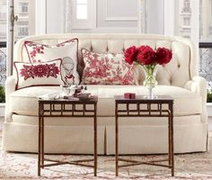 Such a fresh look for spring - a white sofa, red and white Pierre Frey toile de jouy pillows, red peonies, and using a pair of faux bamboo end tables as a coffee table.