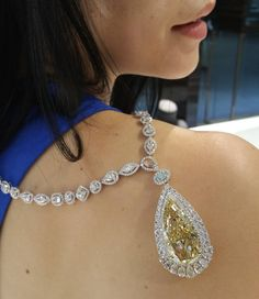$4mill diamond necklace featuring white diamonds, two fancy coloured diamonds and a fancy yellow diamond weighing >50ct