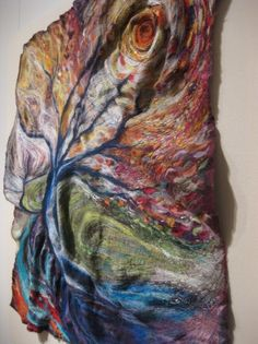Felted and stitched wall hanging by Kayla Coo.  Cool!